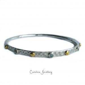 Blue Topaz and brass hammered sterling silver bangle, jewellery handcrafted by Caraliza Designs
