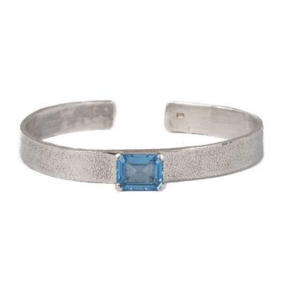 Textured Cuff Bracelet with an Oblong Blue Topaz handcrafted in sterling silver, ethical jewellery by Caraliza Designs