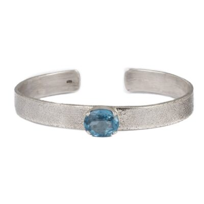 Textured Cuff Bracelet with Oval Blue Topaz handcrafted in sterling silver, ethical jewellery by Caraliza Designs
